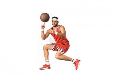 young basketball player spinning ball on finger isolated on white