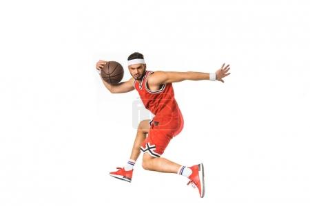 young sportsman playing with basketball ball isolated on white