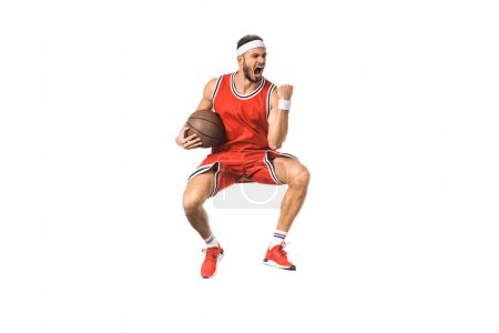 triumphing young basketball player jumping with ball isolated on white