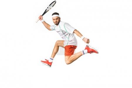 young sportsman jumping while playing tennis isolated on white