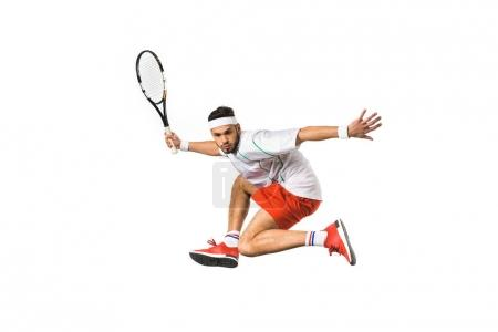 young tennis player holding racquet and playing tennis isolated on white