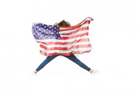 back view of young woman with american flag jumping isolated on white