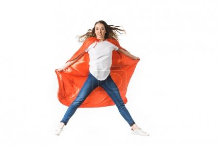 young woman in red mantle jumping and looking at camera isolated on white