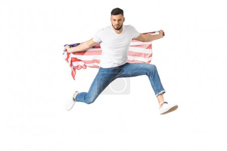 handsome young man holding american flag and jumping isolated on white