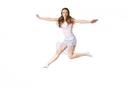 beautiful happy girl jumping and smiling at camera isolated on white