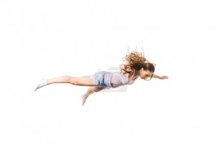full length view of young woman falling and looking down isolated on white