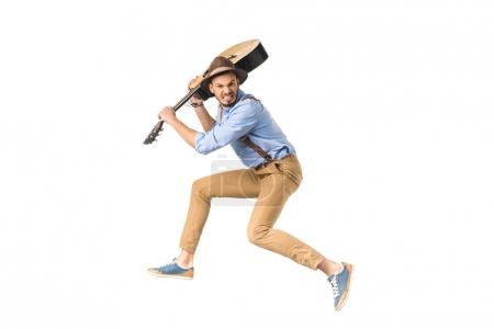 Photo for Angry young man ready to hit with guitar isolated on white - Royalty Free Image
