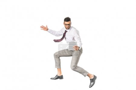 Photo for Young businessman using digital tablet and jumping isolated on white - Royalty Free Image