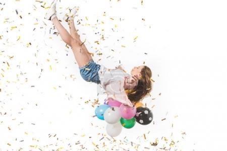 Photo pour Jeune femme avec des ballons colorés et des confettis brillants tombant isolé sur blanc - image libre de droit