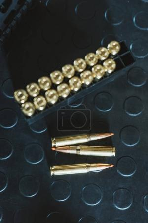 top view of bullets on dark surface