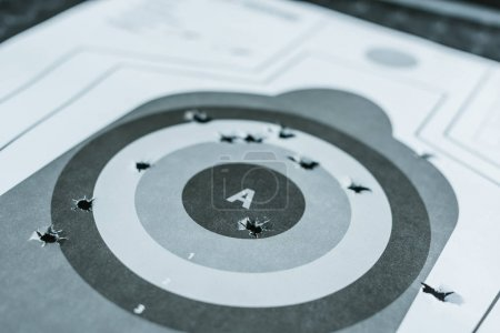 Photo for Close up of used gun target with holes after bullets - Royalty Free Image