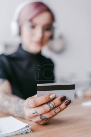 close-up view of young woman holding credit card