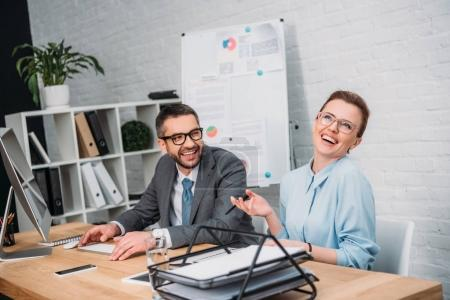 laughing happy business partners at modern office