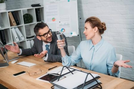 exhausted managers working together at modern office