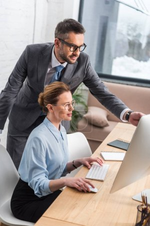successful business partners working with computer together