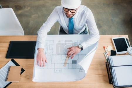 handsome professional architect drawing building plan