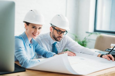 successful architects working with building plan at office