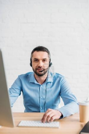 adult technical support professional working at office