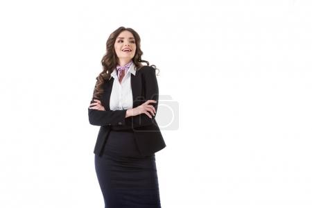 Photo for Laughing stewardess standing with crossed arms isolated on white - Royalty Free Image