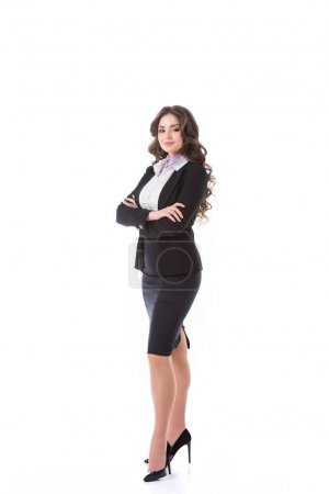 attractive stewardess standing with crossed arms isolated on white