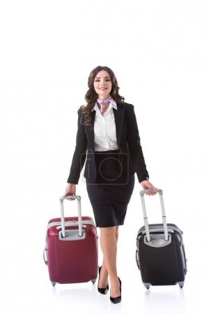 attractive stewardess walking with baggage isolated on white