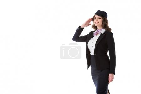 attractive stewardess saluting isolated on white