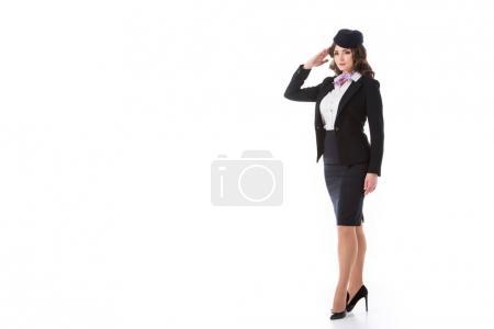 beautiful stewardess saluting isolated on white