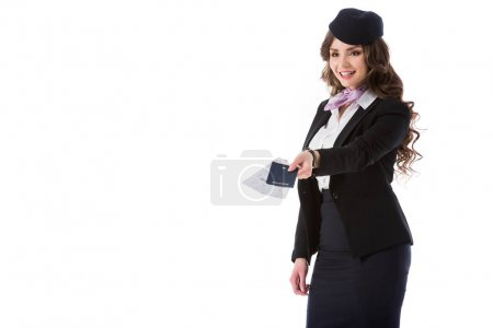 beautiful stewardess giving passport and tickets isolated on white