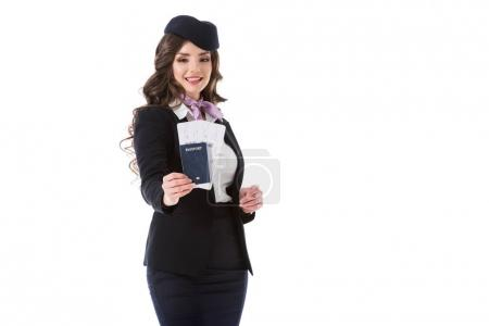 Photo for Attractive stewardess showing passport and tickets isolated on white - Royalty Free Image
