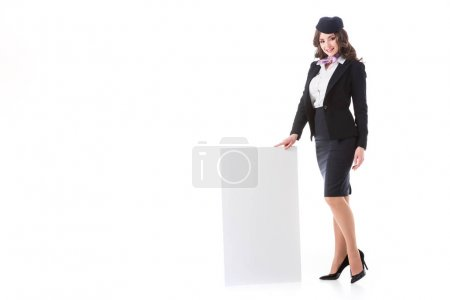 attractive stewardess near empty board isolated on white