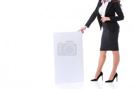 cropped image of stewardess holding empty board isolated on white