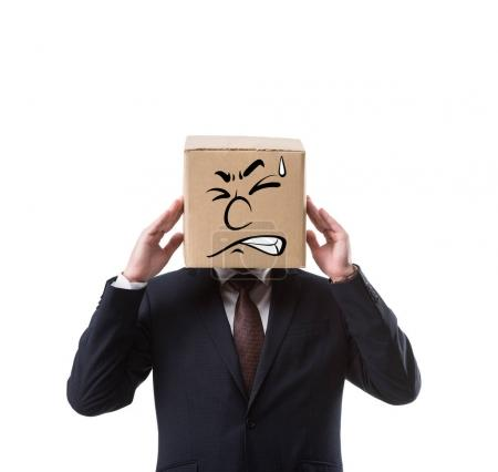 businessman with cardboard box on head having headache isolated on white