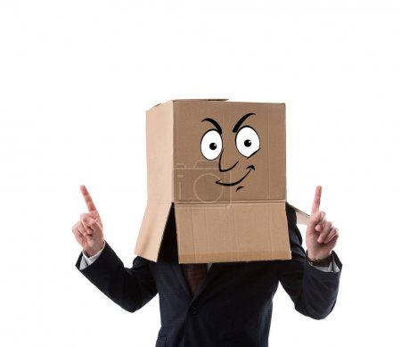 businessman with cardboard box on head pointing up with fingers  isolated on white