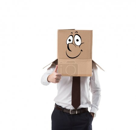 businessman with cardboard box on his head showing thumb up, isolated on white