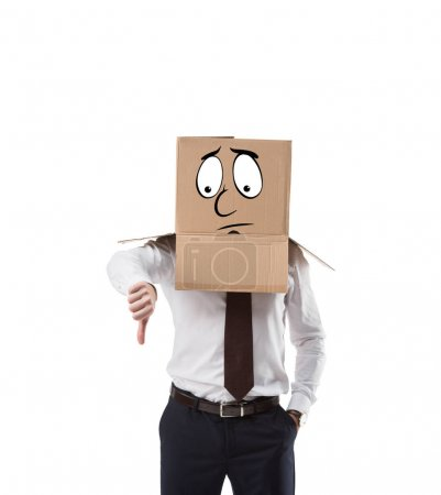 businessman with cardboard box on his head showing thumb down isolated on white