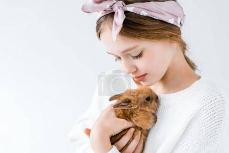 close-up view of cute child holding adorable furry rabbit isolated on white