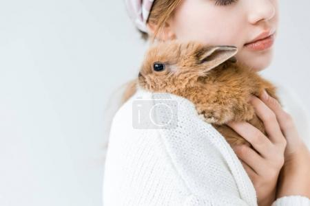 Photo for Cropped shot of child holding cute furry rabbit isolated on white - Royalty Free Image
