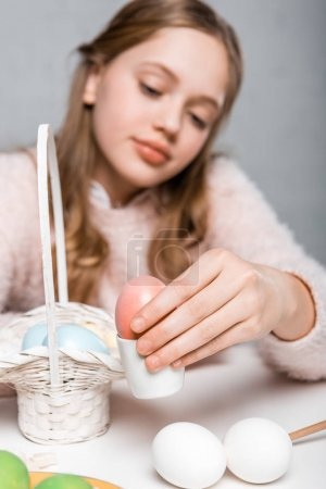 close-up view of girl holding painted easter egg