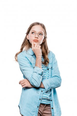 pensive teenage girl in eyeglasses holding hand on chin and looking up isolated on white