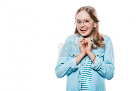 happy girl in eyeglasses showing hand heart symbol and smiling at camera isolated on white