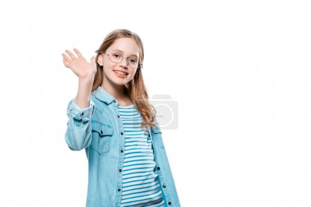 cute teenage girl waving hand and smiling at camera isolated on white