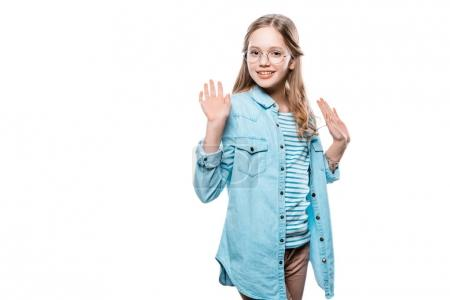 Photo for Cute teenage girl raising hands and smiling at camera isolated on white - Royalty Free Image