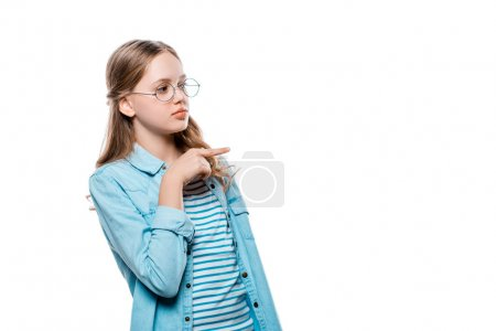 beautiful teenage girl in eyeglasses pointing away with finger isolated on white