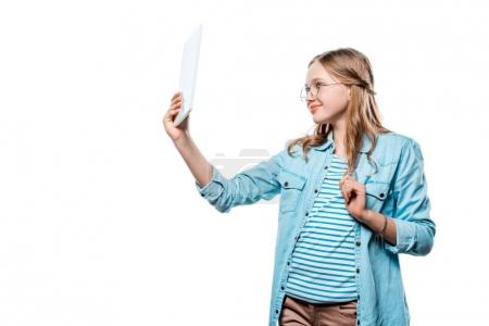 smiling girl in eyeglasses holding digital tablet isolated on white