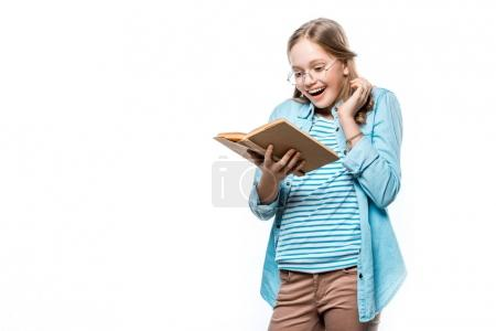 happy teenage girl in eyeglasses reading book isolated on white