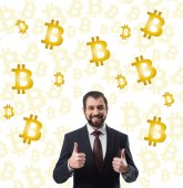 bearded smiling businessman in suit showing thumbs up and bitcoin symbols isolated on white