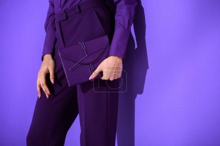 Photo for Cropped view of girl in purple suit holding purple diary, ultra violet trend of 2018 year - Royalty Free Image