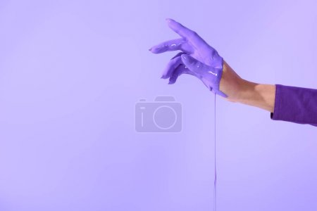 cropped view on elegant female hand in purple paint, isolated on ultra violet