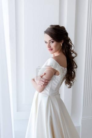 attractive bride in elegant wedding dress