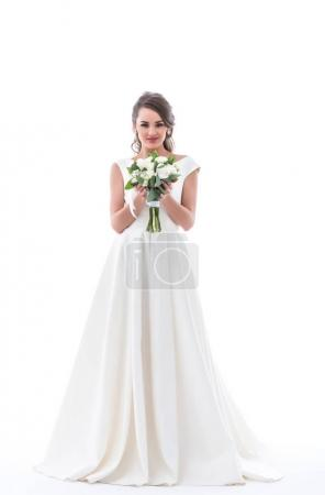 happy young bride posing in traditional white dress with wedding bouquet, isolated on white